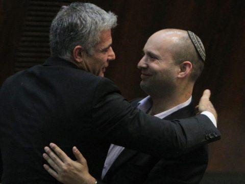Lapid hugs Jewish Home party chief Naftali Bennett following Lapid's first speech at the Knesset, Feb. 11, 2013. (Photo/Miriam Alster-Flash90-JTA)