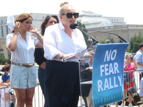 Meghan McCain speaks at the rally as Israeli actress Noa Tishby and Arizona State Rep. Alma Hernandez look on, July 11, 2021. (Photo/JTA-Ron Kampeas)