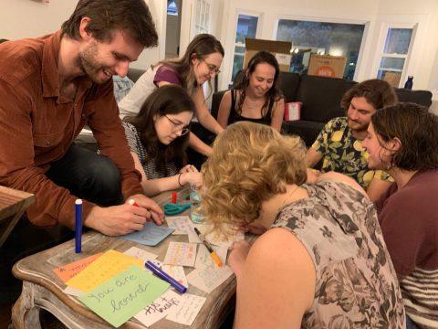 Participants at a Moishe House Oakland-Lake Merritt event build menstrual hygiene kits for homeless women.