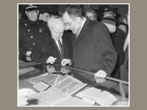 Prime Minister David Ben-Gurion (left) of Israel views rare books and scriptures under glass in a case at the library in the Jewish Theological Seminary in New York, 1960. (Photo/JTA-Getty Images)