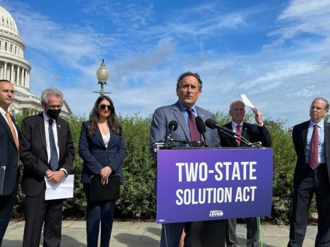 """Rep. Andy Levin speaks at a press conference introducing his """"Two-State Solution Act"""" on Capitol Hill, Sept. 23, 2021. He is flanked by (from left) Hadar Susskind, CEO of Americans for Peace Now; Rep. Alan Lowenthal; Rep. Sara Jacobs; Rep. Peter Welch; and J Street President Jeremy Ben-Ami. (Photo/JTA-Ron Kampeas)"""