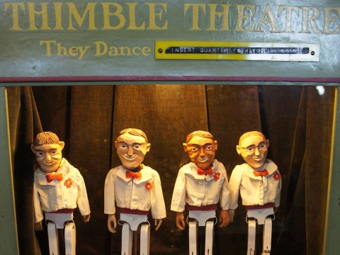 Agile wooden dancers show off their steps on the small stage of the Mechanical Museum's Thimble Theater.