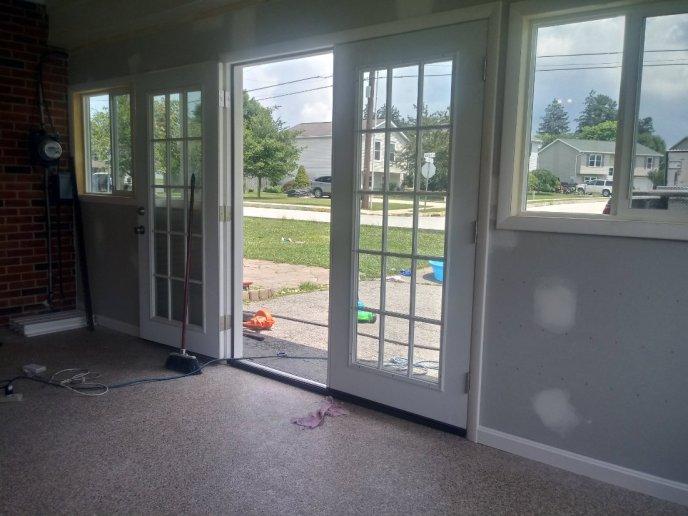 Custom trim around walls and windows in this garage addition