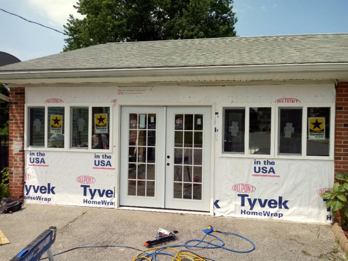Doors and Windows installed in the new wall, wrapped in tyvek weatherproofing