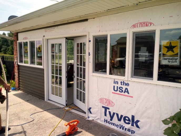 Beginning the installation of the new siding on the garage addition