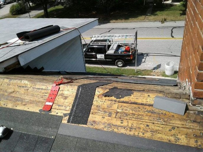 Exposed roof ridge for ridge vent and cap installation during this New Oxford PA roofing installation service by JWE