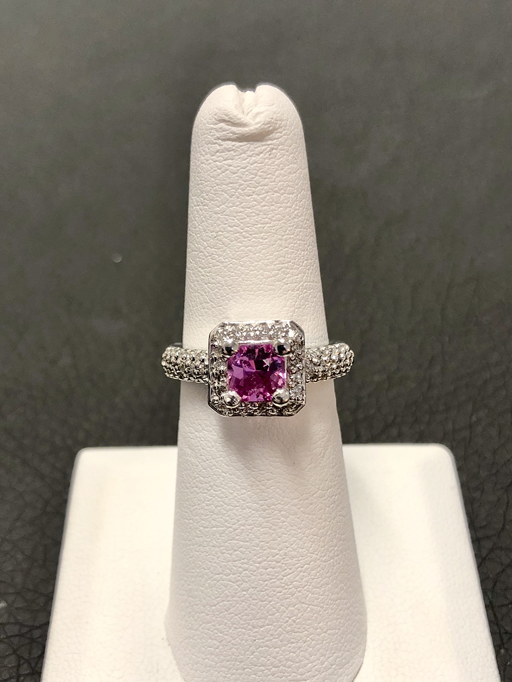 Pink sapphire and diamond halo ring