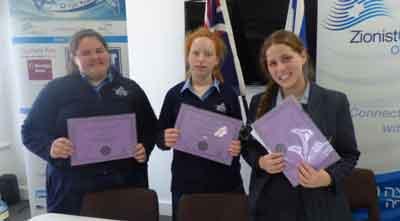 Bible Quiz contestants from left: Ariella Woolf (Beth Rivkah Ladies College), Ruth Slonimsky (runner up Beth Rivkah Ladies College) and winner Chaya Leah Kaltmann (Leibler Yavneh College)