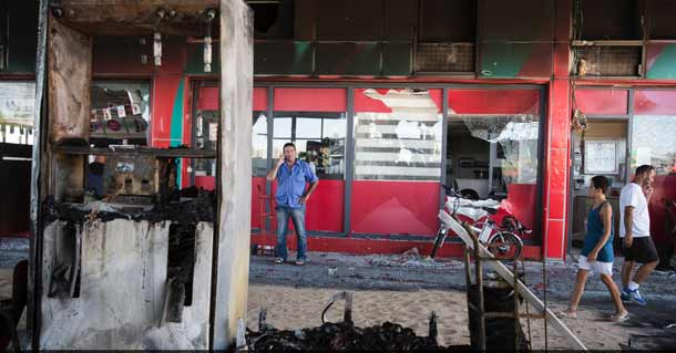 The scene of a gas station in Ashdod that was hit directly by rocket fire from Gaza on the fourth day of Operation Protective Edge, July 11, 2014. Credit: Hadas Parush/Flash90.