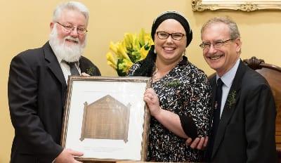 Alderman Bill Harvey (representing Lord Mayor of Hobart City Council) and Jordana Schmidt, President of Hobart Hebrew Congregation....