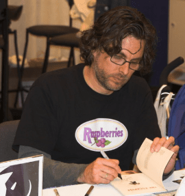 Michael Chabon at a book signing. Credit: Charlie Reiman via Wikimedia Commons.