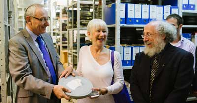 Dame Helen Mirren holds one of the 10,000 reels of film at the Hebrew University's Steven Spielberg Jewish Film Archive. Also pictured: Hebrew University President Prof. Menahem Ben-Sasson (L) and Dean of the Faculty of Humanities, Prof. Dror Wahrman