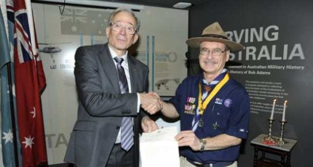 Charles Aronson and Peter Allan show the letter granting funding to the Mark Dapin book project on Jewish military history