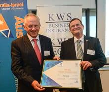 Paul Keen shows his prize with ambassador-designate Shmuel Ben-Shmuel