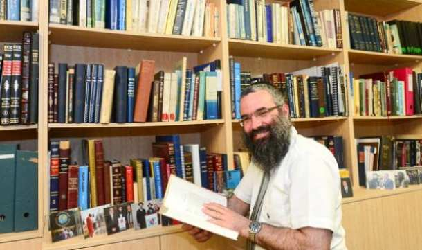 Rabbi Dovid Slavin and some of the 300 books he studied for his thesis    Photo Henry Benjamin