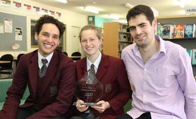 Senior Division Debating Champions Liahm Simon and Lara Joffe, both in Year 10, with their coach, Anthony Small