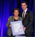 2.Mrs Masha Zeleznikow accepting the Leo & Mina Fink Community Service Award from Jewish Care CEO, Bill Appleby