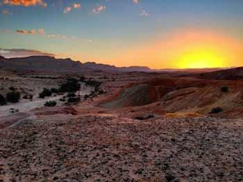 A sunset in Israel's Negev desert. Credit: Matthew Parker via Wikimedia Commons.