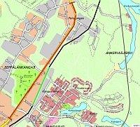 Laukaantien tiesuunnitelman alue on merkitty karttaan punaisella ja ehdotetun Baanareitin mustalla ja vihreällä.