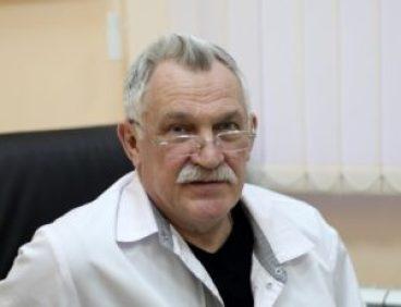 профессор Карев