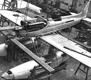 Rolls Royce R Series engine being lowered into the Supermarine S6B during construction