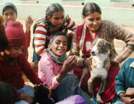 Puppies helping handicapped children in India