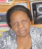 Ms. Lillian Tindyebwa (Director)