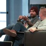 Tony Perez sitting on a couch with Chris Teitzel during a panel at LoopConf 2018