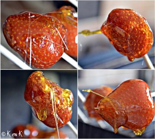 Préparation des fraises d'amour enrobées de caramel et placé sur des piques en bois pour un dessert en amoureux