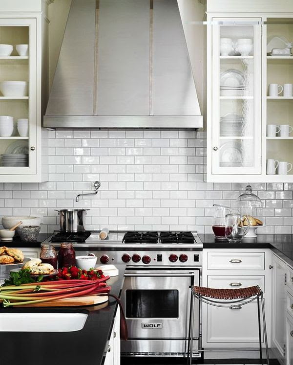 Stainless steel appliances are a simple way of making a white kitchen stand out