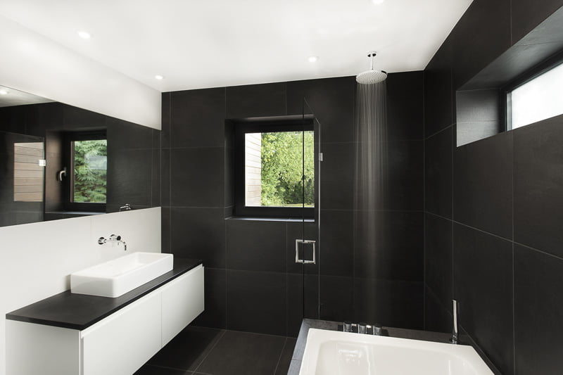 black and white bathroom is in a home in Hampshire, England, designed by AR Design Studio
