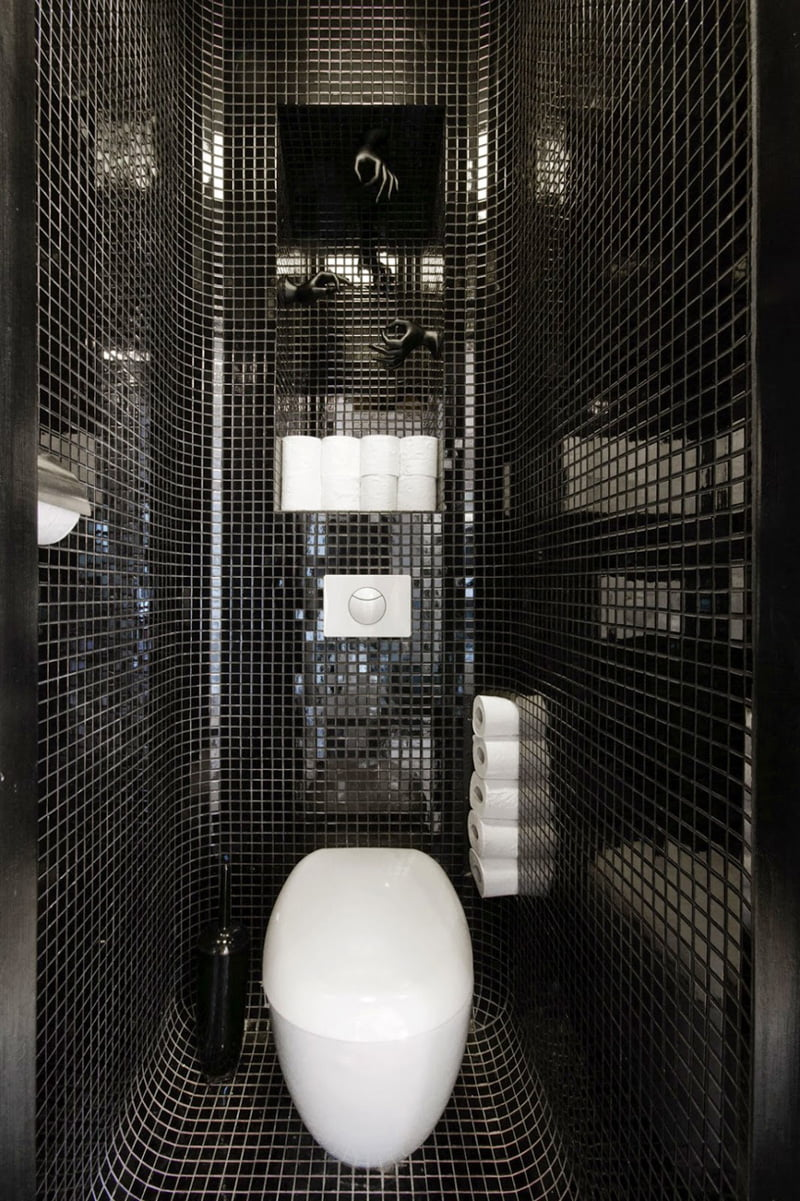 black and white bathroom is in an apartment in Warsaw, Poland, designed by Widawscy Studio Architektury