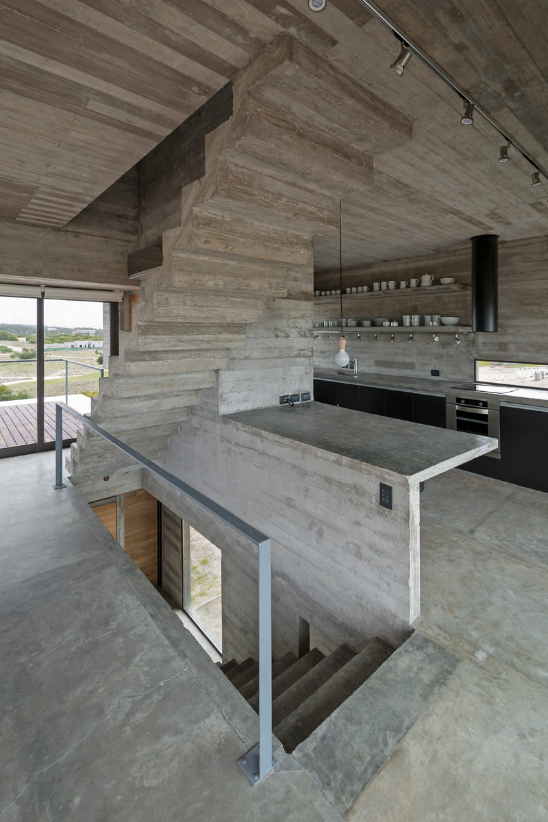 exposed concrete modern house and wooden furniture