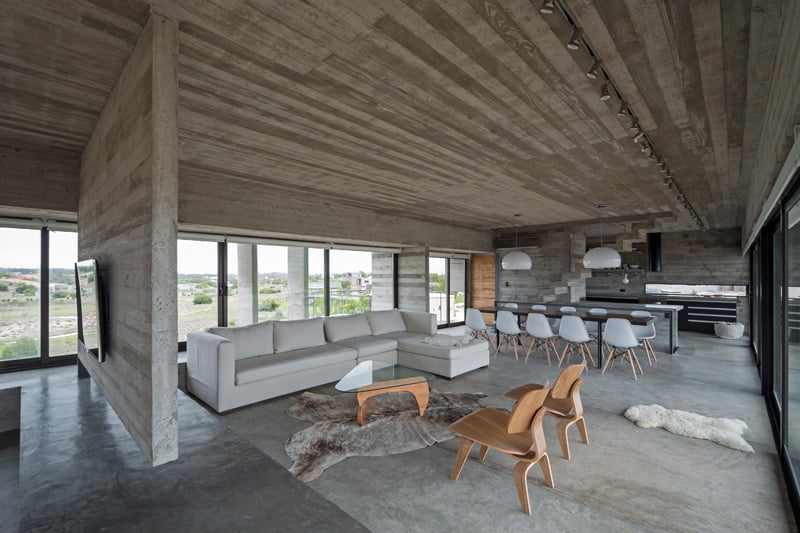 exposed concrete modern house living dining space