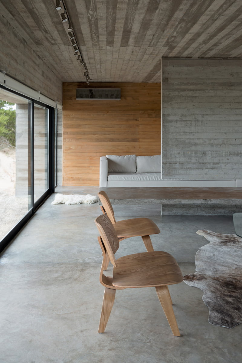 exposed concrete modern house living room wooden interior