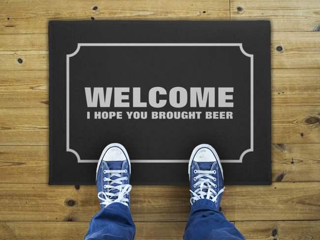 welcome-hope-you-brought-beer-doormat-tagline