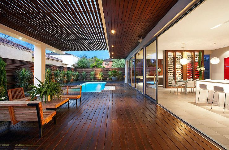 outdoor pool deck wooden flooring and semi covered patio