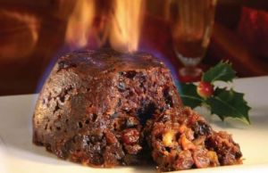 Christmas Plum Pudding set on fire with brandy. Source: fooods.net