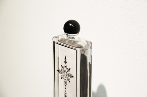 "L'Orpheline special edition ""Croix de Cimetière"" bottle, now available at Palais Royal Serge Lutens, and starting from October in all of Lutens' points of sale. Source: http://grey-magazine.com/l-orpheline"