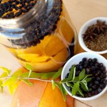 Lemon and juniper berries. Source: liquor.com