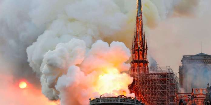 Smoke and flames rise during a fire at the landmark Notre-Dame Cathedral in central Paris on April 15, 2019, potentially involving renovation works being carried out at the site,