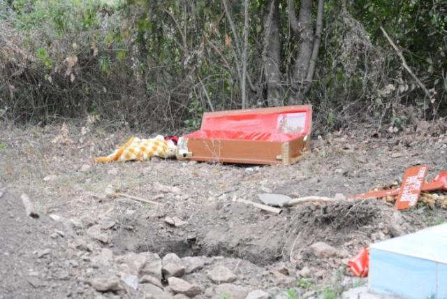woman exhumes daughter's remains