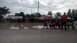 Some of the residents stranded on the road at Ahero market. [PHOTO/ COURTESY]