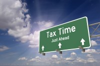 Tax time ahead road sign concept