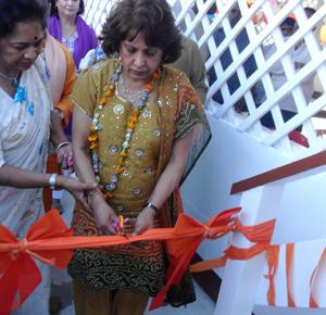 sylvia sobraj cutting ribbon at cove and john ashram