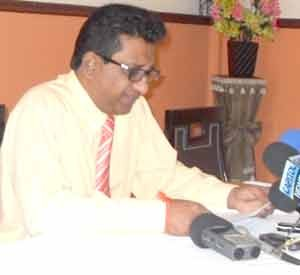 Former Attorney General Anil Nandlall reads a statement to the media