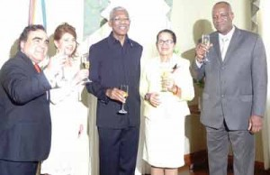 (From L to R) Chile's Ambassador to Guyana, Claudio Rojas and his wife, Martiza Del Carmen Perez Quimbaya along with President David Granger and First Lady Sandra Granger with Minister of State Joseph Harmon as they toasted to Chile's 205th Independence anniversary