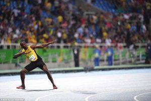 Bolt performs his trademark lightning bolt celebration after capturing the gold medal on Thursday night.