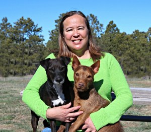 Gwen Kaawaloa at Kaimana Equestrian with her dogs