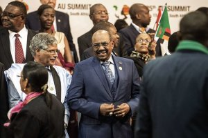 President Omar al-Bashir of Sudan, center, posed for a group picture on Sunday at the African Union summit meeting in Sandton, South Africa. GIANLUIGI GUERCIA / AGENCE FRANCE-PRESSE — GETTY IMAGES
